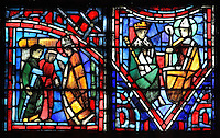 Fulbert helping sick pilgrims (left) and Fulbert as advisor to King Robert the Pious (right), from the Life of Fulbert stained glass window, in the south transept of Chartres Cathedral, Eure-et-Loir, France. This window replaces the original 13th century window depicting the Life of St Blaise, which was destroyed in 1791. It was created in 1954 by Francois Lorin as a gift of the Institute of American Architects, on a theme chosen by the Canon Yves Delaporte. It depicts the life of Fulbert, bishop of Chartres in the 11th century. Chartres cathedral was built 1194-1250 and is a fine example of Gothic architecture. Most of its windows date from 1205-40 although a few earlier 12th century examples are also intact. It was declared a UNESCO World Heritage Site in 1979. Picture by Manuel Cohen
