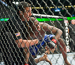UFC referee John McCarthy protects Mackens Semerzier after stopping the fight against Robbie Peralta during Saturday's UFC on Fox event at the Honda Center.