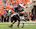 September 18 - Champaign, Illinois, USA - Illinois quarterback Nathan Scheelhaase (2)  leaps for extra yardage in the game between the University of Illinois Fighting Illini and the Northern Illinois University Huskies at Memorial Stadium.  The Illini defeated the Huskies 28 to 22.