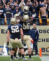 Pittsburgh running back Dion Lewis (28) celebrates a touchdown with teammates Joe Thomas (56) and Lucas Nix (52). The Pittsburgh Panthers defeated the South Florida Bulls 41-14 at Heinz Field, Pittsburgh, PA on October 24, 2009.