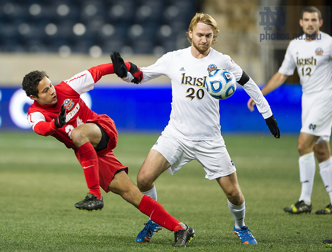 Dec. 13, 2013; Notre Dame defender Grant Van De Casteele tangles with New Mexico forward Niko Hansen in the second half of the College Cup semifinals at PPL Park in Chester, Pa. Notre Dame advances to the finals after defeating New Mexico 2-0. Photo by Barbara Johnston/University of Notre Dame