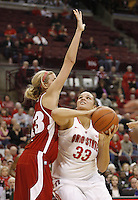 Ohio State's Ashley Adams (33) puts up a shot against Wisconsin's Cassie Rochel (43) during their NCAA basketball game Thursday, Feb. 7, 2013, in Columbus Ohio. (Photo for the Dispatch by Mike Munden)