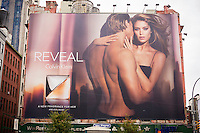 A Calvin Klein billboard for his Reveal brand fragrance in the Soho neighborhood of New York on Saturday, October 11, 2014. Klein's advertisements use sex and provocative images to test society's cultural and moral boundaries. (© Richard B. Levine)