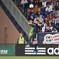 Seattle Sounders defender Tyson Wahl (5) and New England Revolution midfielder Pat Phelan (28) battle for head ball. In a Major League Soccer (MLS) match, the Seattle Sounders FC defeated the New England Revolution, 2-1, at Gillette Stadium on October 1, 2011.