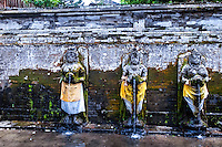 Bali, Gianyar, Goa Gajah. The elephant cave. Holy water fra Gunung Batur. Three of the statues in the old bathing pools.