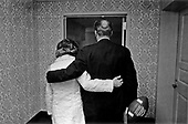 United States President Gerald R. Ford and his wife, first lady Betty Ford, walk down the hallway in the Presidential Suite at Bethesda Naval Hospital in Bethesda, Maryland on October 4, 1974.  In the President's hand is the game ball from last Monday's Washington Redskins game, which was presented by the team.  Mrs. Ford is in the hospital recovering from cancer surgery.<br /> Mandatory Credit: David Hume Kennerly / White House via CNP