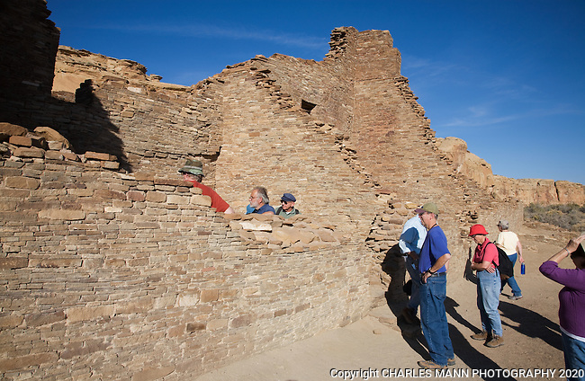 Visitors join a brief tour of the ruins of Pueblo Bonito,one of the larger Anasazi settlements at  Chaco Culture National Historical Park in northewest New Mexico