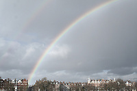 Rainbows and clouds over Battersea Park on a winter day in London
