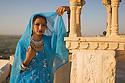 Rajasthani girl on roof top, Jaisalmer Fort, Jaisalmer, Rajastan, India --- Model Released