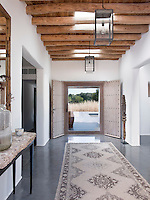 In keeping with preserving and respecting traditional Ibizan architecture the house has an original double wooden front door but also a contemporary glass one that affords a beautiful view of the countryside