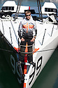 23rd April 2010. Portsmouth . UK..Pictures of Alex Thomson and his new Hugo Boss IMOCA Open 60 race yacht. Shown here as the yacht is launched and lifted into Endevour Quay. Portsmouth..Mandatory credit: Lloyd Images