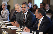 United States President Barack Obama, center, speaks during a Cabinet Meeting as U.S. Secretary of State Hillary Rodham Clinton, left, and U.S. Secretary of Defense Leon Panetta listen in the Cabinet Room at the White House in Washington, DC on January 31, 2012. From left to right: U.S. Secretary for Health and Human Services (HHS) Kathleen Sebelius; U.S. Secretary of the Interior Ken Salazar (partially obscured); Secretary Clinton; President Obama; Secretary Panetta..Credit: Olivier Douliery / Pool via CNP