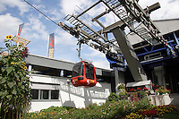 MOUNTAIN TRANSPORTATION<br /> Gondola Lift Or Cable Car Leaving The Terminal<br /> Mt. Pilatus, Switzerland. A cable car is a type of aerial lift which consists of a loop of steel cable that is strung between two stations, over intermediate supporting towers