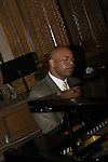 Musician Rob Murat singing and playing piano at 2nd Annual Interfaith Memorial Service for Haiti, at Brooklyn Borough Hall, Brooklyn, New York, USA, on January 11, 2012, two years after the Mw 7.0 earthquake in Haiti.