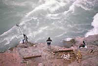 Native American Indians fishing for Salmon in Chilcotin River, Cariboo Chilcotin Coast Region, BC,  British Columbia, Canada