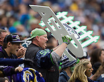 """Seattle Seahawks fan Lorin """"Big Lo"""" Sandretzky cheers on the Seattle defensive unit during the second quarter against the Baltimore Ravens at  CenturyLink Field in Seattle, Washington on November 13, 2011. The Seahawks beat the Ravens 22-17."""