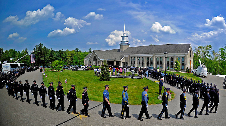 (Charlton, MA, 05/26/16) Police from across the country walk in formation while attending a wake for Auburn police officer Ronald Tarentino Jr. at St. Joseph's Catholic Church in Charlton on Thursday, May 26, 2016. According to state police, Jorge Zambrano shot and killed Auburn police officer Ronald Tarentino Jr. early Sunday morning. Photo by Christopher Evans