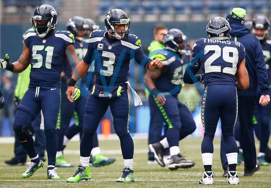 Russell Wilson #3 of the Seattle Seahawks warms up prior to the game against the Pittsburgh Steelers at CenturyLink Field on November 29, 2015 in Seattle, Washington. (Photo by Jared Wickerham/DKPittsburghSports)
