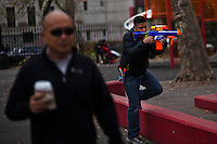 A boy plays with a toy gang at Manhattan's Chinatown in New York, Nov 11, 2013. VIEWpress/Eduardo Munoz Alvarez