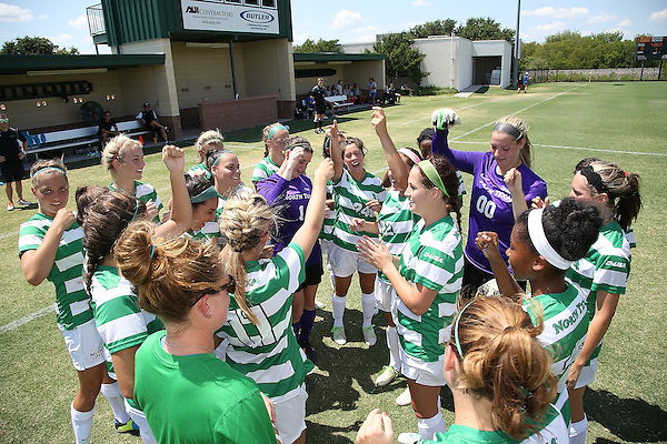 DENTON, TX- AUGUST 25: Haley Riley and Jackie Kerestine #0 of the North Texas Mean Green and team - Houston Baptist vs North Texas Mean Green Soccer team at Mean Green Village Soccer Field in Denton on August 25, 2013 in Denton, Texas. Photo by Rick Yeatts