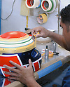 "Motorcycle racers and ""normal"" motorcyclists can have their Arai helmet totally ""customised"". Complex designs mean a lot of masking off work before they can be sprayed on."