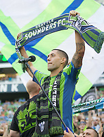 Clint Dempsey takes part in pre-match festivities after being introduced as a Sounder before a game against the Sounders FC and FC Dallas at CenturyLink Field in Seattle Saturday August, 3, 2013. The Sounders defeated Dallas 3-0.