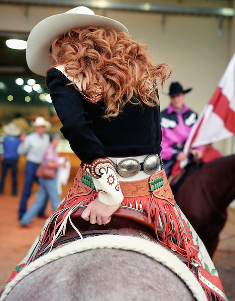 KISSIMMEE, FLORIDA - OCTOBER 11:Florida's Miss Rodeo, Tiffany Brown sits on a horse and talks to  friends before entering the arena at a PRCA (Professional Rodeo Cowboys Association ) Pro Rodeo event in Kissimmee, Florida, USA.  The Xtreme Bulls Series was established in 2003 by the PRCA as a way to showcase rodeos most popular event bull riding. The Xtreme Bulls makes 10 stops in 8-cities, are televised and feature the best in bull riding from the bulls to the cowboys. Kissimmee, Florida. USA.