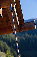 While the original cladding was retained for the walls of the chalet, the roof was replaced, held in place by steel wires