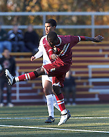 Boston College midfielder/defender Atobra Ampadu (6) follows through on a shot. Boston College (maroon) defeated Virginia Tech (Virginia Polytechnic Institute and State University) (white), 3-1, at Newton Campus Field, on November 3, 2013.