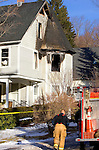NORFOLK, CT- 04 JANUARY 2008 --010409JS03-Norfolk Volunteer Fire Department as well as a State Fire Marshal investigate a fire that broek out Sunday morning at this home at 25 Shepard Road in Norfork. A woman who lives in the house as well as a firefighter were taken to separate hospitals for smoke inhalation. <br /> Jim Shannon / Republican-American