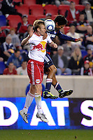Tim Ream (5) of the New York Red Bulls and Chris Cortez (27) of CD Chivas USA go up for a header. CD Chivas USA defeated the New York Red Bulls 3-2 during a Major League Soccer (MLS) match at Red Bull Arena in Harrison, NJ, on May 15, 2011.