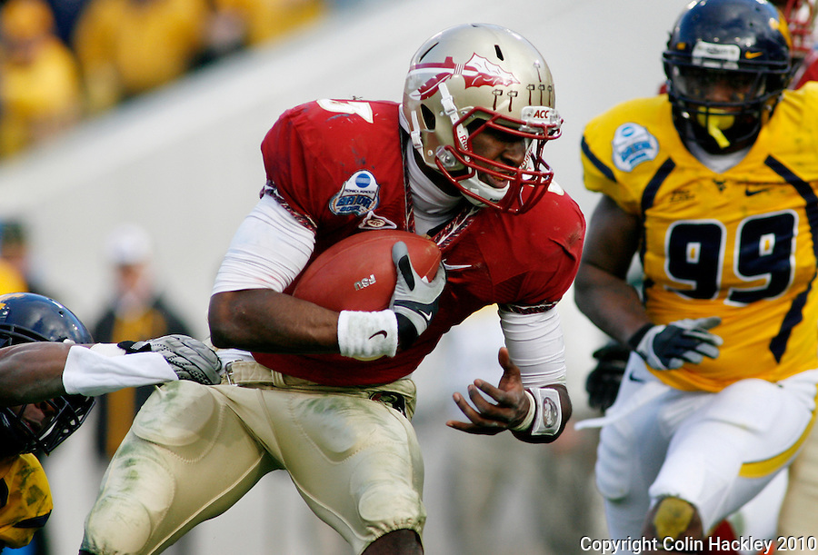 JACKSONVILLE, FL 1/1/10-FSU-WV FB CH61-Florida State's EJ Manuel breaks a tackle to score a touchdown against West Virginia during second half Gator Bowl action Friday in Jacksonville, Fla. The Seminoles beat the Mountaineers 33-21..COLIN HACKLEY PHOTO