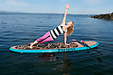 PE00293-00...WASHINGTON - Carly Hayden doing paddle board yoga in the Puget Sound at Brackett's Landing North, Edmonds.  (MR #H13)