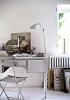 Varying shades of white in the office area create a tranquil working environment