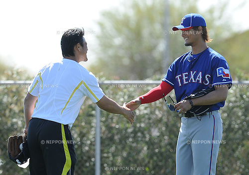 (R-L) Yu Darvish (Rangers), Akinori Otsuka,.FEBRUARY 26, 2012 - MLB :.Yu Darvish of the Texas Rangers shakes hands with former Texas Rangers pitcher Akinori Otsuka during the Texas Rangers spring training camp in Surprise, Arizona, United States. (Photo by AFLO)