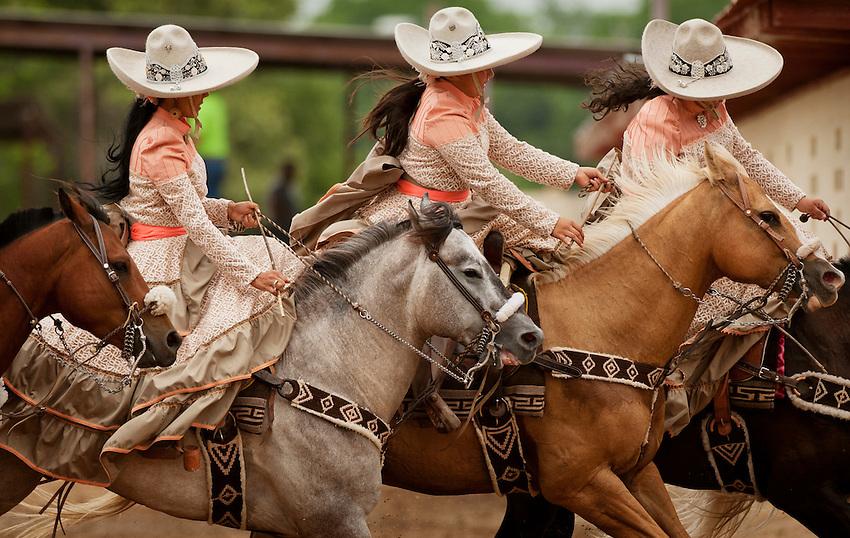 Escaramuza riders perform during Fiesta Charreada, Sunday, April 29, 2012, at San Antonio Charro Ranch in San Antonio, TX, USA. (Darren Abate/pressphotointl.com)