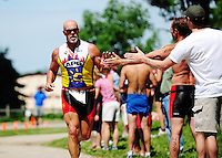Runners compete in the triathlon to kick of the Badger State Summer Games on Sunday at Fireman's Park in Verona, Wisconsin