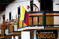 Residents watch from their balcony people celebrating the Colombia's 202th Independence Day parade in Tamesis, July 20, 2012. Photo by Kena Betancur / VIEW.