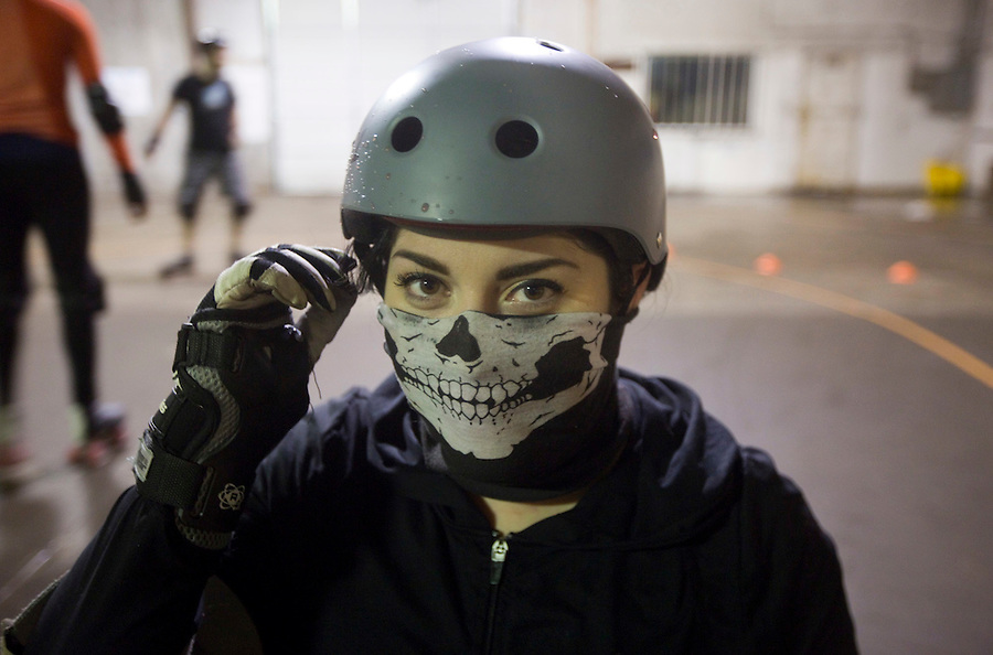 Darkness, of the Storm City Roller Girls practices while wearing a face mask in Vancouver Thursday February 9, 2017. (Photo by Natalie Behring for the Columbian)