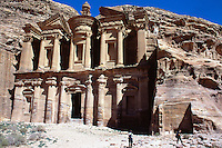 "Jordan. Petra.The archeological site is part of the UNESCO world heritage project.  The Nabataeans were an arabian industrious tribe which settled down in southern Jordan 2000 years ago. Petra is located at the bottom of a spectacular deep gorge surrounded by mountains. "" Al-Dayr"" monastery. Its high façade is carved in the rocks.  German tourists looking at the height and the beauty of the building. © 2002 Didier Ruef"
