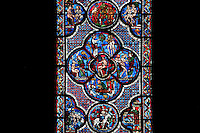 Detail of the creation of Adam and Eve from left to right, the forbidden fruit on the top, The Good Samaritan and Adam and Eve window, circa 1210, Chartres Cathedral, Eure et Loir, France Picture by Manuel Cohen