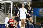 02 November 2012: Maryland's Olivia Wagner (11) defends a header against Wake Forest's Kim Marshall (right) and Ally Berry (8). The Wake Forest University Demon Deacons played the University of Maryland Terrapins at WakeMed Stadium in Cary, North Carolina in a 2012 NCAA Division I Women's Soccer and Atlantic Coast Conference Tournament semifinal game. Maryland won the game 2-0.