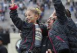 Vanderbilt head coach James Franklin carries his daughters Addy, left, and Ava, right, off the field after the University of Kentucky vs. Vanderbilt University football game at Vanderbilt Stadium in Nashville, Tenn., on Saturday, November 16, 2013. Vanderbilt won 22-6. Photo by Tessa Lighty | Staff