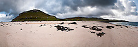 Coral Beach, isle of Skye, Scotland. This stretch of white beach on the right is part of the Coral Beaches of Skye, a mass of (not coral) but dissicated algae (Maerl - Lithothamnion) mixed with small shells, and unique on this island. Loch Dunvegan bathes this white beach.
