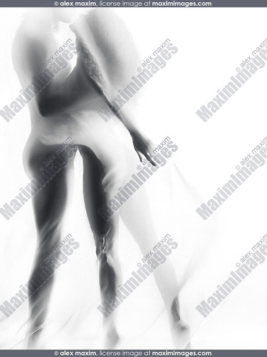 Beautiful surreal photo of a sexy nude couple silhouettes kissing standing behind white sheer veil of a curtain on white background Artistic sensual concept