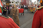 Hunting the Earl of Rone. Combe Martin Devon England. 2011. The procession through the village. The Earl of Rone is about to be shot. The Captain gives the orders to the Grenadiers.