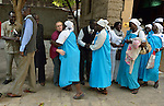 The Rev, Kirsten Fryer greets participants at the end of a worship service of Nuer refugees from South Sudan who live in Cairo, Egypt. The service took place at St Andrews United Church of Cairo.