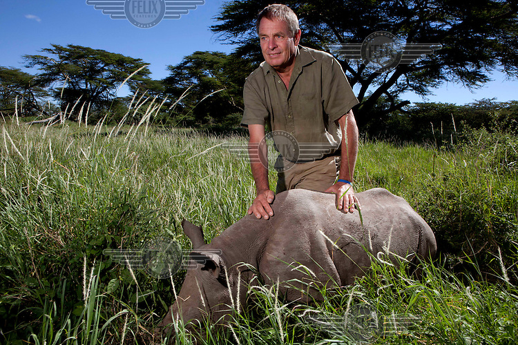 Ian Craig wih a young hand reared Rhino at the Lewa wildlife conservancy.The Lewa Wildlife Conservancy, a non profit organisation, was created by Ian Craig out of his parent's cattle ranch in the 1980s. Situated near the town of Meru, north of Mount Kenya, it covers 62,000 acres and is home to over 10 % of Kenya's black rhino population and over 14% of the country's white rhinos. In recent years, the conservancy has faced increased incursions from poachers and now employs a team of 30 armed rangers and another 44 scouts who patrol 24 hours a day and call in armed support if they encounter poachers. /Felix Features