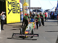 Feb 14, 2016; Pomona, CA, USA; Crew members push NHRA top fuel driver Terry McMillen to the starting line during the Winternationals at Auto Club Raceway at Pomona. Mandatory Credit: Mark J. Rebilas-USA TODAY Sports