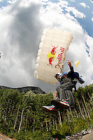 Shane McConkey lands during World Base Race 2008, the first event where BASE jumpers compete to be the fastest flying down from a mountain, before deploying their parachute. The contestants jump from a mountain in the fjord Innfjorden in Western Norway, two jumpers race each other to the finish line 750 meters horizontally from the mountain. Shane McConkey was killed in a ski-BASE accident March 26th 2009.